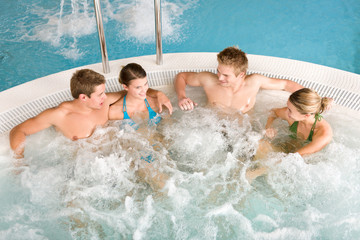 Top view - happy people relax in hot tub