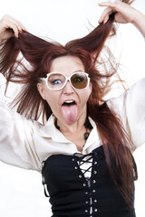 red-haired woman sticking out her tongue