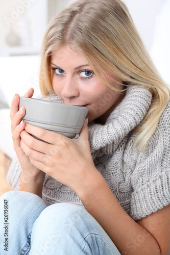 Beautiful woman drinking hot drink in winter