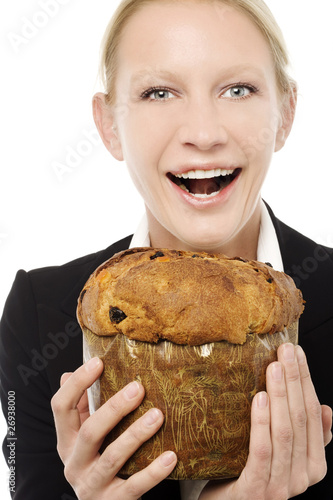businesswoman smiling and holding a panettone cake