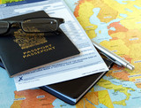 Canada passport with business travel necessities on the map poster