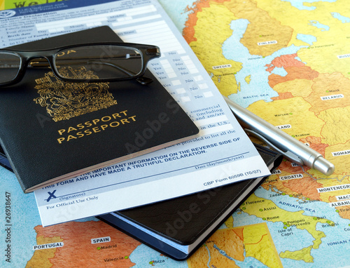 Canada passport with business travel necessities on the map