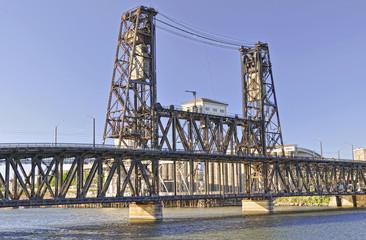 metal bridge across a river in portland oregon