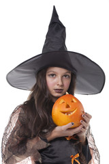 girl on halloween costume and pumpkin