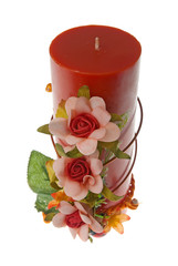 Large red candle with the flower decoration