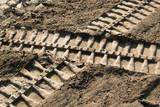 Bulldozer footprints intersect poster