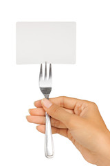 womans hand holding a fork with card