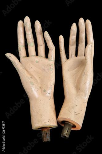 Weathered severed hands of plastic mannequin doll.