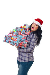 Surprised woman holding heavy Xmas  presents