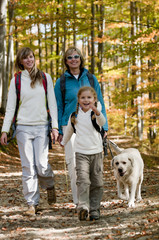 Family with dog on autumn trek
