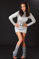 brunette woman posing in silver clothes