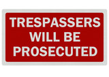 Bright, clean, 'trespassers will be prosecuted' sign on white