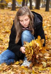 teenage girl in autumn park