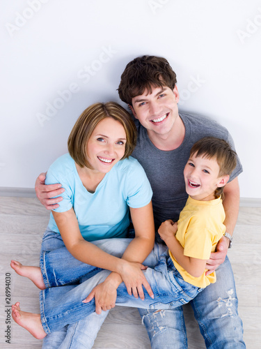 Laughing family with boy high-angle