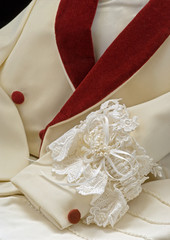 Formalwear tuxedo with wedding garter & white gloves