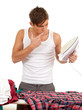 young man ironing clothes, housework