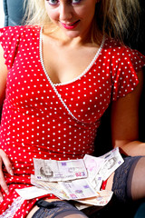 Young Woman with Cash on Lap. Model Released