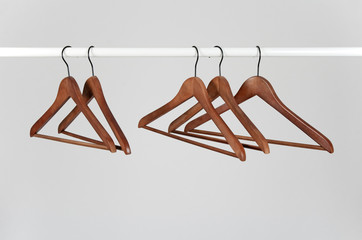 Wooden hangers on a rod