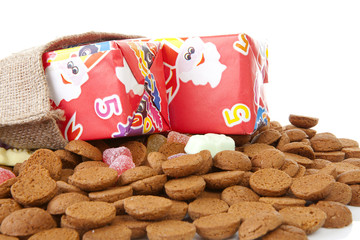 bag with presents and typical dutch sweets: pepernoten (ginger n