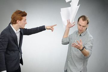 chief arguing and businessman throwing documents