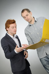 two young business men arguing