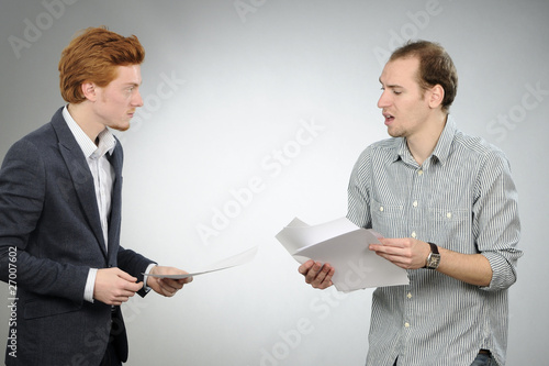 nervous manager explaining documents to his chief