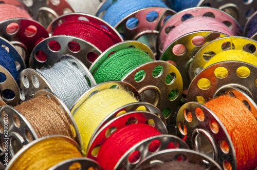 Colorful spools of yarn in a close-up