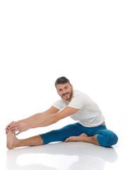 Handsome active man doing yoga fitness poses. isolated on white