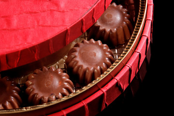 close up shot of chocolates in a red box