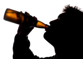 Man drinking bottle of cider