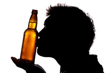 Man kissing bottle of cider