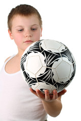 Small boy holding the soccer ball isolated on white