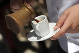 Fototapety Waiter is pouring coffee