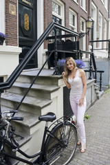 Woman Standing Next to Bicycle