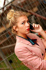 Young Woman Using Mobile Telephone. Model Released