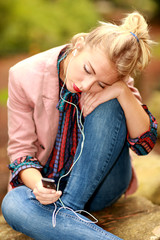 Young Woman Listening to Music. Model Released