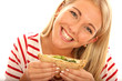 Young Woman Eating a Sandwich. Model Released