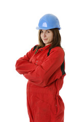 young female manual worker in coveral and helmet
