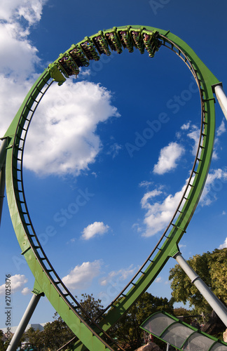 A Roller Coaster Train doing a loop. - 27025876