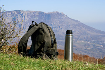 backpack and thermos