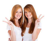 happy young sisters giving peace sign - Fine Art prints