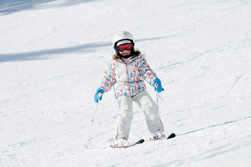 Little girl skiing downhill