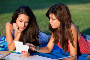 Teenage college students studying outdoor in a university campus