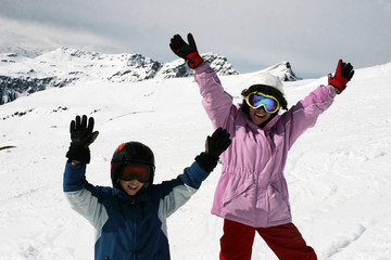 Teenager girl and boy on ski vacation