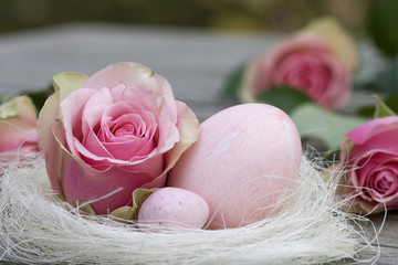 Easter eggs with rose close-up
