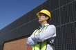 Maintenance worker with photovoltaic array in Los Angeles, California