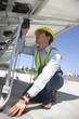 Maintenance worker adjusting solar panel in Los Angeles, California