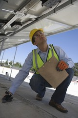 Maintenance worker checking solar panel in Los Angeles, California