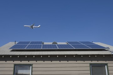 Aeroplane and rooftop with solar array, Inglewood, Los Angeles, California