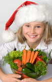 Little Santa with bunch of vegetables